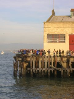 welcoming crowd on pier at Fort Mason